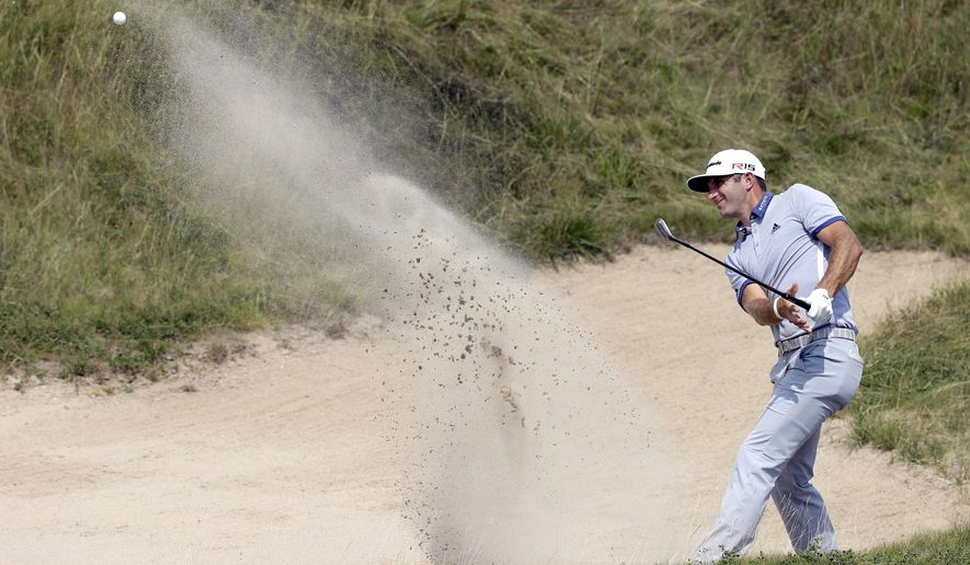 Dustin Johnson hits from a bunker on the first hole during the fourth round of the PGA Championship golf tournament Sunday, Aug. 16, 2015, at Whistling Straits in Haven, Wis. (AP Photo/Jae Hong)