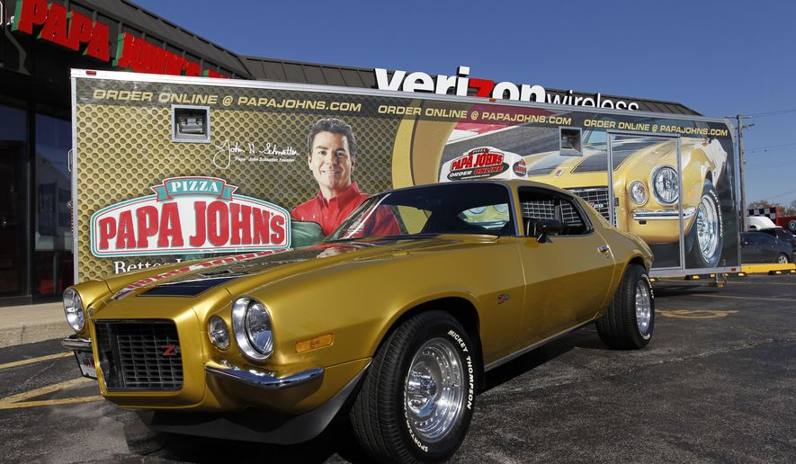 FILE - In this Monday, Oct. 24, 2011, file photo, Papa John's Founder, Chairman, and CEO John Schnatter's 1971 Chevy Camaro is shown at the Papa John's 3000th North American Store Celebration in Burbank, Ill. Officials say the Camaro is among three vehicles stolen during a Detroit-area event showcasing classic cars on Sunday, Aug. 16, 2015. (Ross Dettman/AP Images for Papa John's, File)