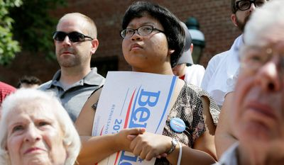 Sonya Zhan, of Iowa City, Iowa, (center) was one supporter who came out to hear a speech by Mr. Sanders delivered in Marion, Iowa, Sunday. (Associated Press)