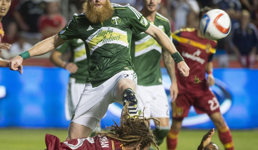 RPortland Timbers defender Nate Borchers connects with the ball during an MLS soccer match against Real Salt Lake, Saturday, Aug. 15, 2015, in Sandy, Utah. (Rick Egan/The Salt Lake Tribune via AP)