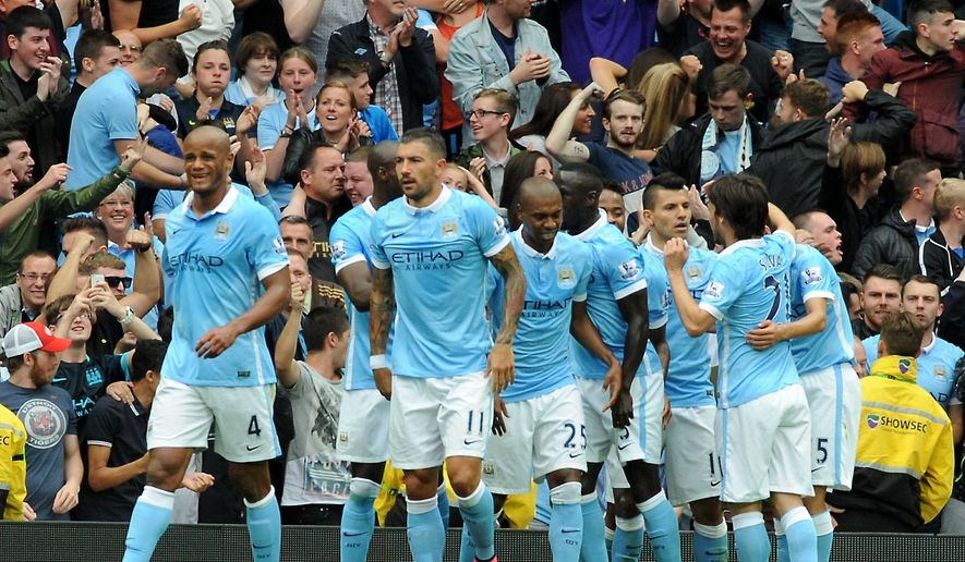 Manchester City players celebrate after Sergio Aguero, 2nd right, scored against Chelsea during the English Premier League soccer match between Manchester City and Chelsea at Etihad stadium, Manchester, England, Sunday, Aug. 16, 2015. (AP Photo/Rui Vieira)