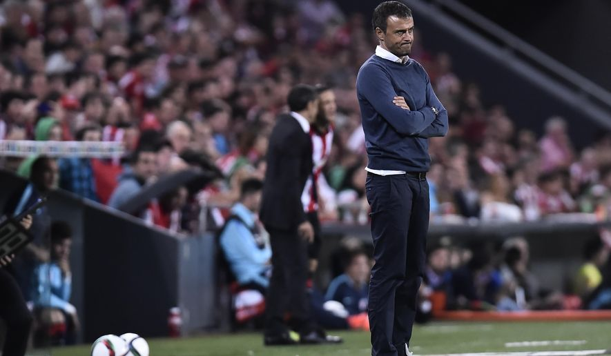 FC Barcelona's head coach Luis Enrique grimaces after Athletic Bilbao scored a goal  during their Spanish Super Cup soccer match first leg, at San Mames stadium in Bilbao, northern Spain, Friday, Aug. 14, 2015.  FC Barcelona lost the match 4-0. (AP Photo/Alvaro Barrientos)