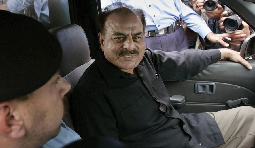 FILE - In this Nov. 4, 2007 file photo, former chief of Pakistan Inter Services Intelligence (ISI)  Hameed Gul sits in a police vehicle in Islamabad, Pakistan. Family members say on Sunday, Aug. 16, 2015, Hameed Gul, the former head of Pakistan's Inter-Services Intelligence spy agency during the end of the Soviet occupation of Afghanistan and who supported Islamic militants, has died of a brain hemorrhage. He was 78. (AP Photo/B.K. Bangash, File)