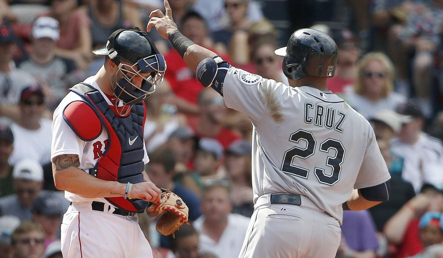 Seattle Mariners' Nelson Cruz (23) celebrates his solo home run in front of Boston Red Sox's Blake Swihart during the seventh inning of a baseball game in Boston, Sunday, Aug. 16, 2015. (AP Photo/Michael Dwyer)