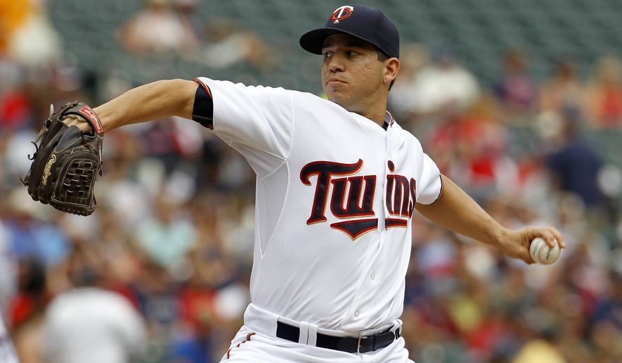 Minnesota Twins starting pitcher Tommy Milone delivers to the Cleveland Indians during the first inning of a baseball game in Minneapolis, Sunday, Aug. 16, 2015. (AP Photo/Ann Heisenfelt)