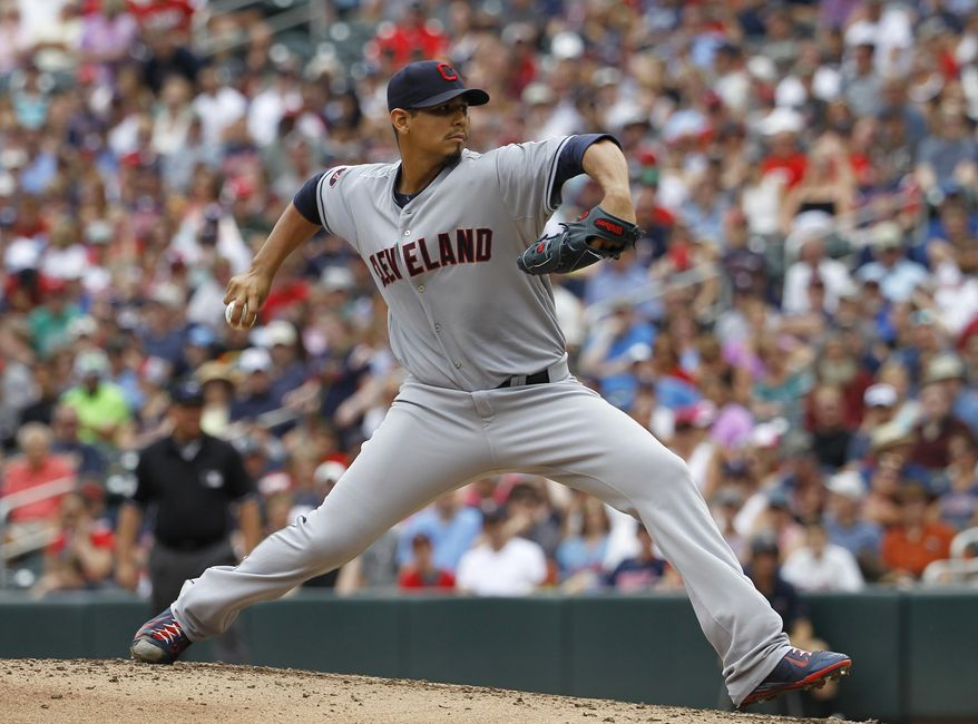 Cleveland Indians starting pitcher Carlos Carrasco delivers to the Minnesota Twins during the first inning of a baseball game in Minneapolis, Sunday, Aug. 16, 2015. (AP Photo/Ann Heisenfelt)