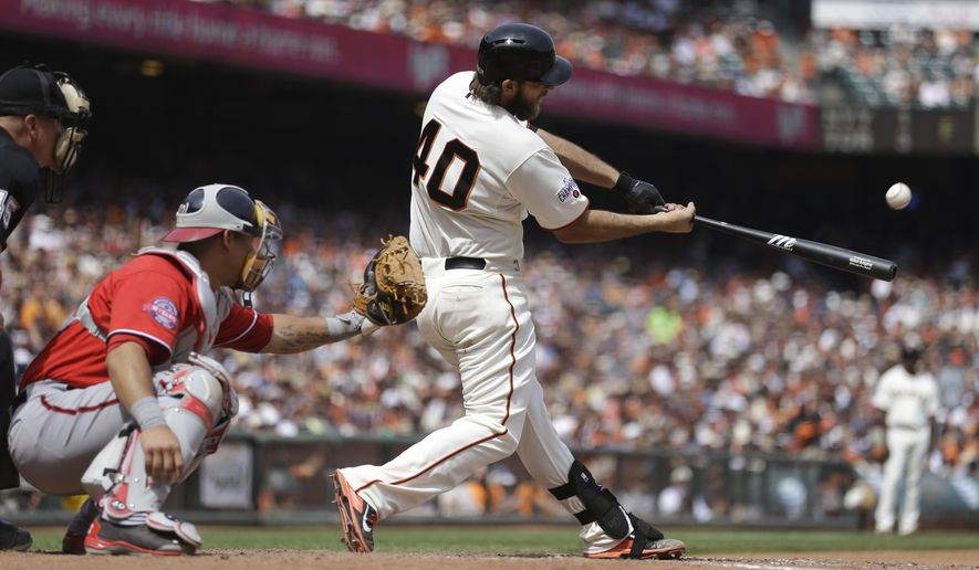 San Francisco Giants' Madison Bumgarner (40) swings for a home run off Washington Nationals' Casey Janssen in the seventh inning of a baseball game Sunday, Aug. 16, 2015, in San Francisco. (AP Photo/Ben Margot)