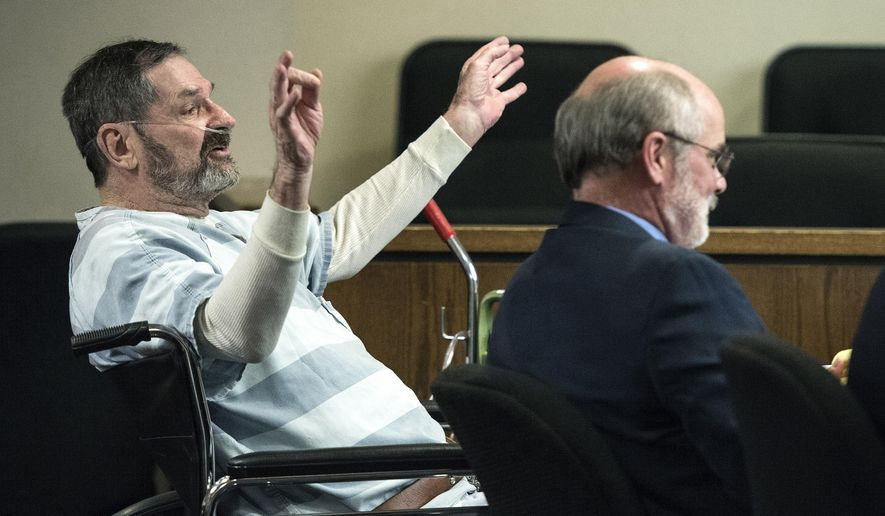 """FILE- In this March 27, 2015, file photo, Frazier Glenn Miller, left, gestures as he speaks at the Johnson County Courthouse, in Olathe, Kan. Jury selection begins Monday, Aug. 17, 2015, for Miller, who could face the death penalty if convicted of killing three people at two suburban Kansas City Jewish sites last year. Frazier Glenn Miller has admitted in court that he killed the three, but he claims """"compelling necessity"""" was grounds to do so.  (John Sleezer/The Kansas City Star via AP, File)"""