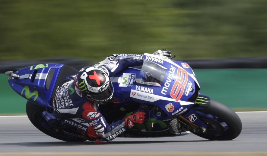Yamaha rider Jorge Lorenzo from Spain cuts a curve during the MotoGP race at the Motorcycle Grand Prix of the Czech Republic at the Masaryk circuit in Brno, Czech Republic, Sunday, Aug. 16, 2015. (AP Photo/Petr David Josek)