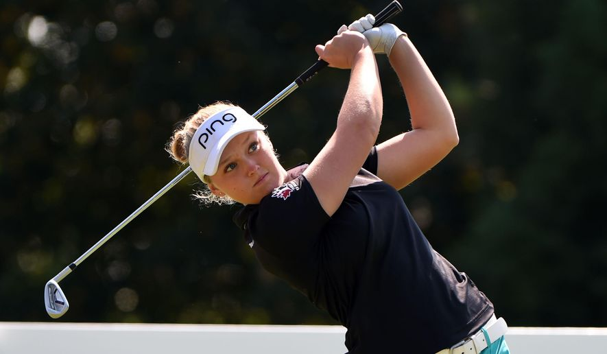 Brooke M. Henderson, of Canada, hits her tee shot on the second hole during the final round of the Cambia Portland Classic golf tournament in Portland, Ore., Saturday, Aug. 16, 2015. (AP Photo/Steve Dykes)