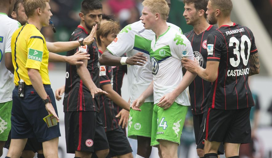Wolfsburg's Kevin De Bruyne discusses after he was fouled during the German Bundesliga soccer match between VfL Wolfsburg and Eintracht Frankfurt in Wolfsburg, Germany, Sunday, Aug. 16, 2015.(AP Photo/Joerg Sarbach)