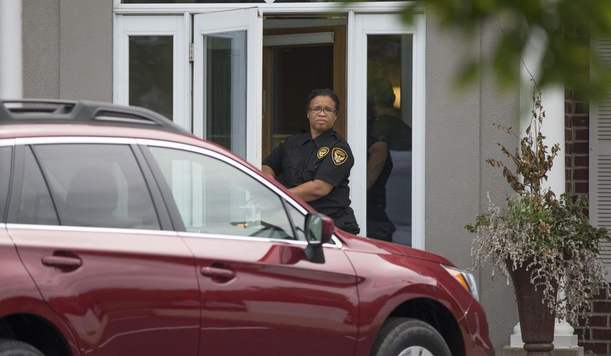 A security guard stands outside Dr. Walter Palmer's office in Bloomington, Minn.,as it reopens Monday, Aug. 17, 2015. The River Bluff Dental office in Bloomington had closed after a barrage of criticism for Palmer over the protected lion he killed in Zimbabwe. The office of Walter Palmer said in a tweet Monday that it will begin to see patients once again, although Palmer is not on site. (Renee Jones Schneider/Star Tribune via AP)  MANDATORY CREDIT; ST. PAUL PIONEER PRESS OUT; MAGS OUT; TWIN CITIES LOCAL TELEVISION OUT