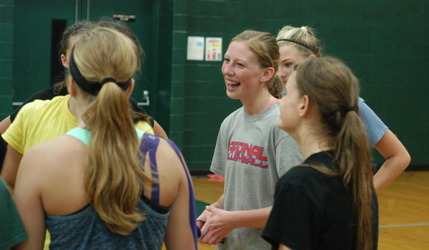 In a Aug. 12, 2015 photo, Pine River High School sophomore KayLee Goodman smiles during volleyball practice in Leroy, Mich. Goodman, who was hit in the right eye with a baseball foul ball last spring, will wear glasses in the classroom and protective goggles on the athletic court as she adjusts to what she can and can't do. She's putting in extra time with coach Jana Dennis to find ways to compensate for her vision loss, too. (Marc Vieau/Cadillac News via AP)