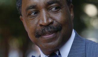 Judge Rossie D. Alston, from Manassas, Va, smiles as he leaves the General Assembly Building in Richmond, Va., Monday, Aug. 17, 2015, after appearing before the Joint Judicial Panel where he was interviewed for the Virginia Supreme Court. (Bob Brown/Richmond Times-Dispatch via AP) ** FILE **