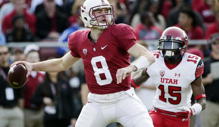 FILE - In this Saturday, Nov. 15, 2014, file photo, Stanford quarterback Kevin Hogan (8) throws against Utah during the first half of an NCAA college football game on in Stanford, Calif. After a down season a year ago, Stanford hopes to get back to the top of the Pac-12. (AP Photo/Marcio Jose Sanchez, File)