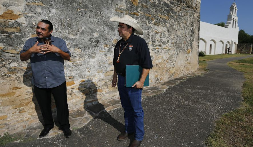 In a Thursday, Aug. 13, 2015 photo, Ramon Vasquez, left, executive director for American Indians of Texas, and Jesus Jose Reyes, Jr., anthropologist and historian for the Taap Piilamm Coahuilan Nation tribe, talk about organizing tours at the San Antonio Missions at Mission San Jose, Texas. The tours, which start at $50, will offer people a perspective from an aboriginal descendant to bring awareness of contributions of Native Americans to San Antonio. (Kin Man Hui/San Antonio Express-News via AP)