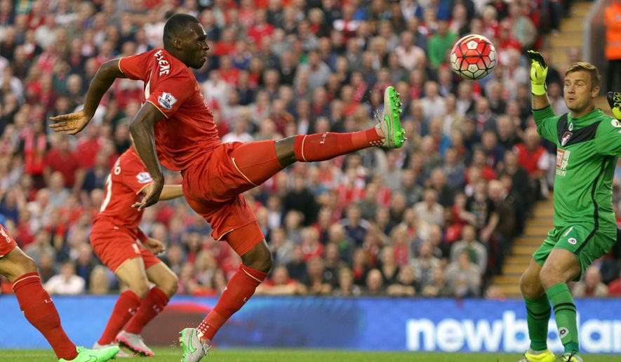 Liverpool's Christian Benteke scores the first goal for his side during their English Premier League soccer match against Bournemouth  at Anfield in Liverpool, England, Monday Aug. 17, 2015. (AP Photo/Clint Hughes)