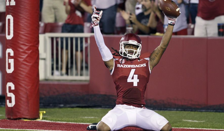 FILE - In this file photo taken Sept. 20, 2014, Arkansas wide receiver Keon Hatcher celebrates his fourth-quarter touchdown in an NCAA college football game against Northern Illinois in Fayetteville, Ark. Arkansas ended last season with a flurry after more than two seasons of suffering and expect to continue that momentum entering Bret Bielema's third season as coach. (AP Photo/Danny Johnston, File)