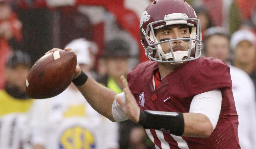 FILE - In this Oct. 11, 2014, file photo, Arkansas quarterback Brandon Allen passes in the first half of an NCAA college football game against Alabama in Fayetteville, Ark. Arkansas ended last season with a flurry after more than two seasons of suffering and expect to continue that momentum entering Bret Bielema's third season as coach. (AP Photo/Danny Johnston, File)