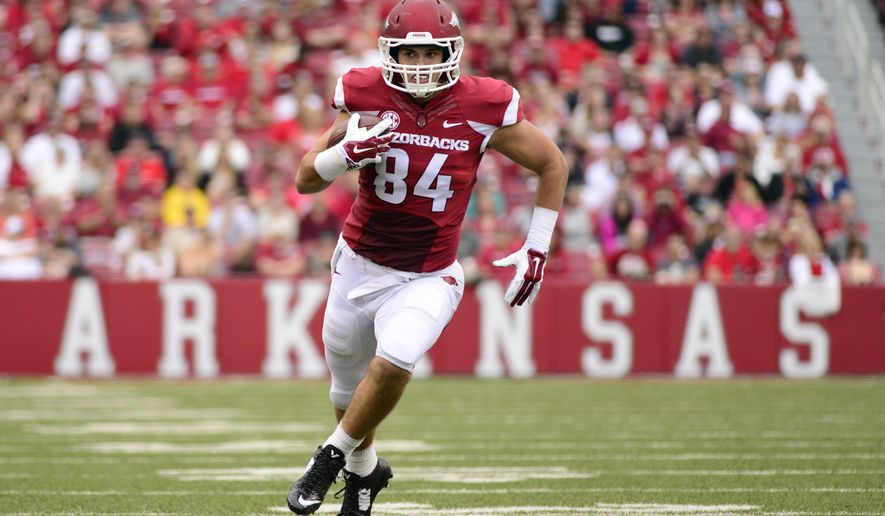 In this photo taken Sept. 6, 2014, Arkansas tight end Hunter Henry carries in the first half of an NCAA college football game in Fayetteville, Ark. (AP Photo/Sarah Bentham)