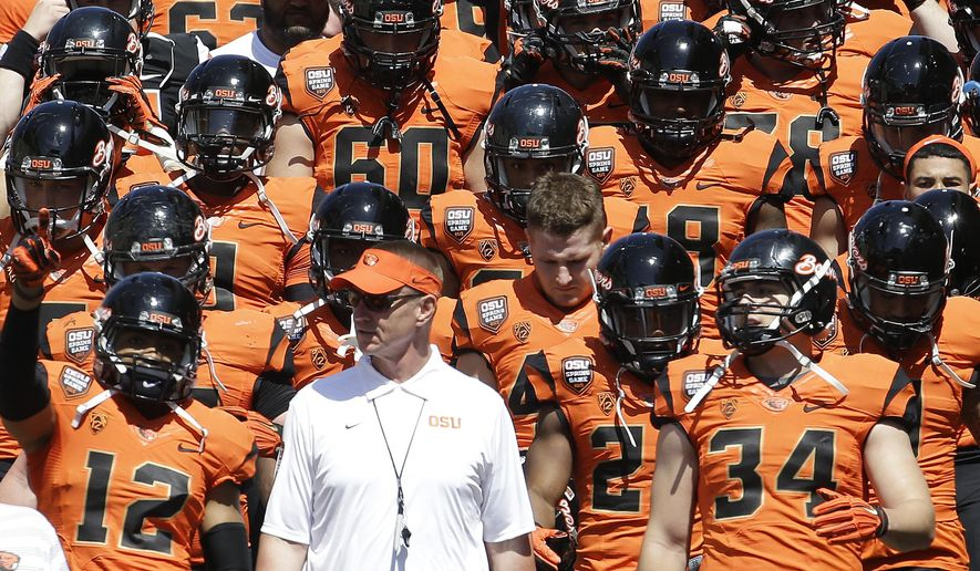 FILE - In this April 18, 2015, file photo, Oregon State football coach Gary Anderson walks onto the field with the orange squad before their NCAA college football spring game in Corvallis, Ore.   It is definitely a time of change for the Beavers with a new coach, a new system, and, if Andersen has his way, a new culture of winning. (AP Photo/Don Ryan, File)
