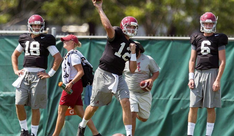 Alabama quarterback David Cornwell (12) throws in passing drills during football practice, Friday, Aug. 14, 2015, at the Thomas-Drew Practice Fields in Tuscaloosa, Ala. (Vasha Hunt/AL.com via AP) MAGS OUT; MANDATORY CREDIT