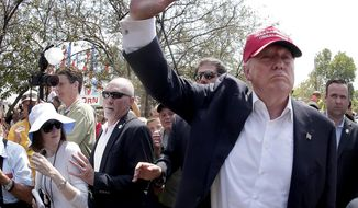 Republican presidential candidate Donald Trump greets his eager public in Iowa. (AP Photo/Charlie Riedel, File)