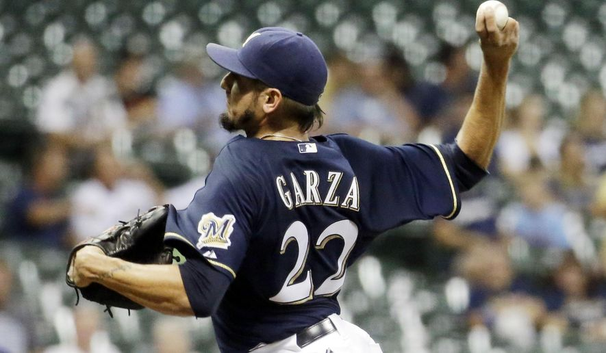 Milwaukee Brewers starting pitcher Matt Garza throws during the first inning of a baseball game against the Miami Marlins Monday, Aug. 17, 2015, in Milwaukee. (AP Photo/Morry Gash)
