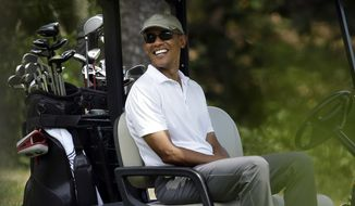 In this Aug. 15, 2015, file photo, President Barack Obama smiles as he sits in a cart while golfing at Farm Neck Golf Club, in Oak Bluffs, Mass., on the island of Martha's Vineyard. So far, one rainy day is the only thing that has dampened Obama's two-week summer vacation on Martha's Vineyard. (AP Photo/Steven Senne, File)