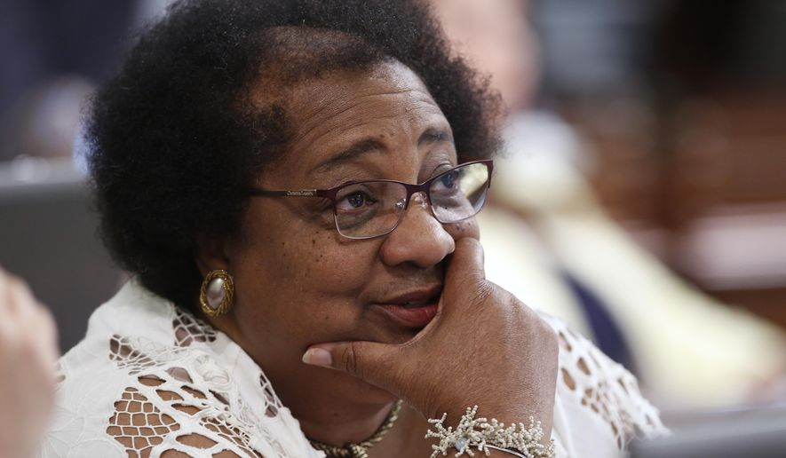 Assemblywoman Shirley Weber, D-San Diego, watches as the votes are posted for her resolution calling for a ban on the display of Confederate flags on federal property and state capitols, Monday, Aug. 17, 2015, in Sacramento, Calif.  The Assembly unanimously approved the measure, AJR26,  with 74 votes.(AP Photo/Rich Pedroncelli)