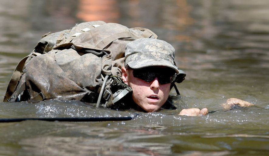 A female Army Ranger student crosses the Yellow River on a rope bridge on Tuesday, Aug. 4, 2015, at Camp James E. Rudder on Eglin Air Force Base, Fla. (Associated Press)
