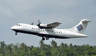 In this photo taken Dec. 26, 2010, Trigana Air Service's ATR42-300 twin turboprop plane takes off at Supadio airport in Pontianak, West Kalimantan, Indonesia. The same type of a Trigana airliner carrying 54 people was missing Sunday, Aug. 16, 2015, after losing contact with ground control during a short flight in bad weather in the country's mountainous easternmost province of Papua, officials said. (AP Photo) ** FILE **