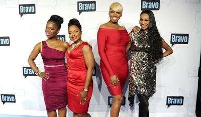 """Real Housewives of Atlanta"" cast members (from left) Kandi Burruss, Phaedra Parks, NeNe Leakes and Cynthia Bailey attend the Bravo network 2012 upfront presentation on April 4, 2012 in New York. (Associated Press)"