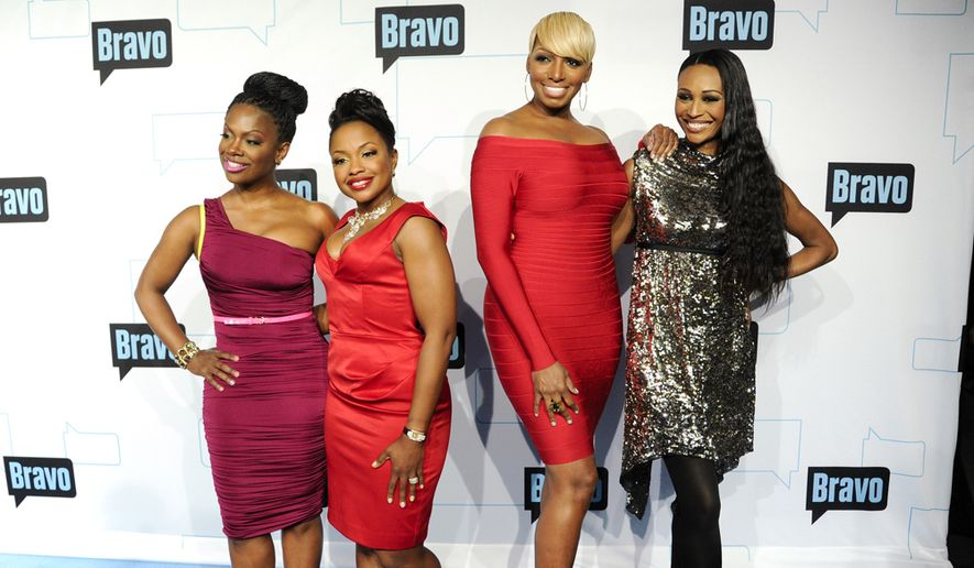 """""""Real Housewives of Atlanta"""" cast members (from left) Kandi Burruss, Phaedra Parks, NeNe Leakes and Cynthia Bailey attend the Bravo network 2012 upfront presentation on April 4, 2012 in New York. (Associated Press)"""