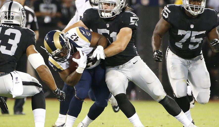In this Aug. 14, 2015,  photo, Oakland Raiders inside linebacker Ben Heeney (51) tackles St. Louis Rams running back Trey Watts (42) during the first half of an NFL preseason football game in Oakland, Calif. Linebacker Heeney's exhibition debut for Oakland went so well that he wanted the jersey as a keepsake. The only problem was it's the only game-ready one the Raiders have for the fifth-round pick. (AP Photo/Tony Avelar)