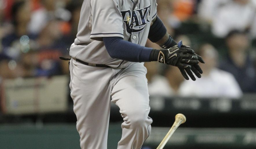 Tampa Bay Rays Tim Beckham hits a home run to left field scoring Logan Forsyte and Asdrubal Cabrera during the first inning of a baseball game, Monday, August 17, 2015, in Houston. (AP Photo/Patric Schneider)