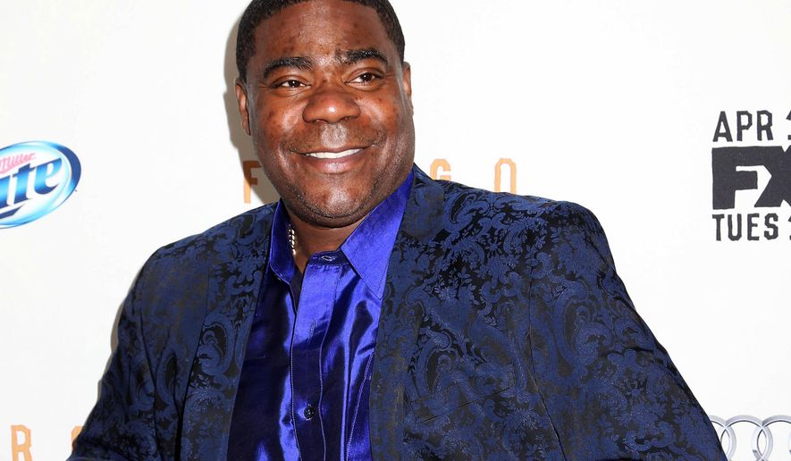 """FILE - In this April 9, 2014 file photo, actor Tracy Morgan attends the FX Networks Upfront premiere screening of """"Fargo"""" at the SVA Theater in New York. On Oct. 17, Morgan will guest host """"Saturday Night Live."""" His appearance also promises to be a coming-out party for the former """"SNL"""" cast member and star of """"30 Rock,"""" who has been recuperating from injuries he suffered in a June 2014 crash.  (Photo by Greg Allen/Invision/AP, file)"""