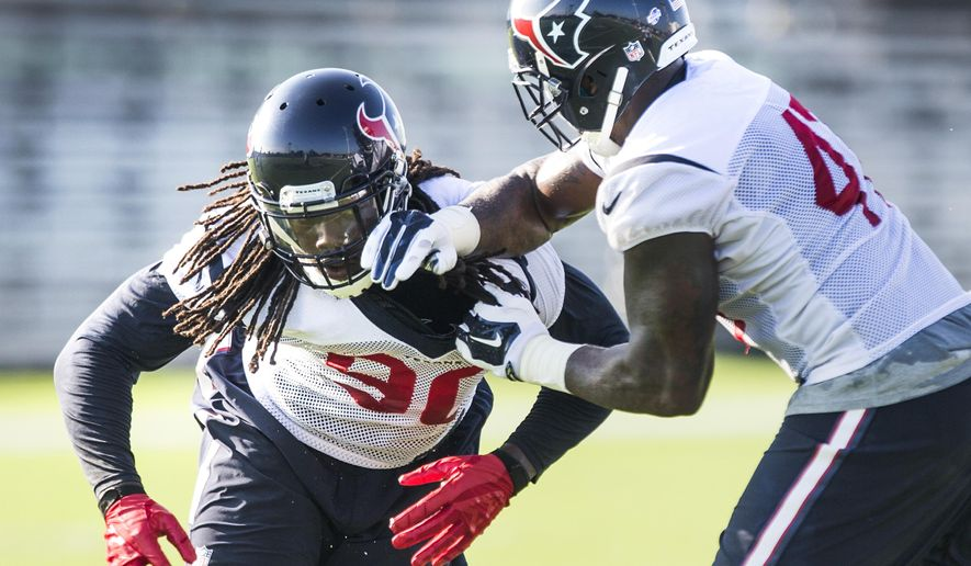 Houston Texans linebacker Jadeveon Clowney (90) and Lynden Trail (47) run a drill during the Texans NFL football training camp Monday, Aug. 17, 2015, in Houston. Clowney returned to practice on a limited basis for the first time since microfracture knee surgery in December. (Brett Coomer/Houston Chronicle via AP) MANDATORY CREDIT