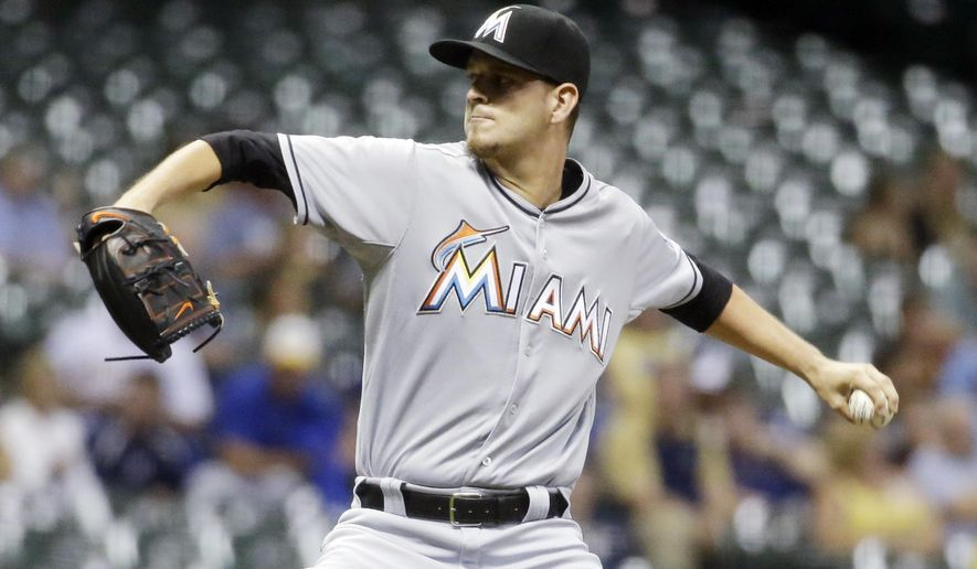 Miami Marlins starting pitcher Justin Nicolino throws during the first inning of a baseball game against the Milwaukee Brewers Monday, Aug. 17, 2015, in Milwaukee. (AP Photo/Morry Gash)
