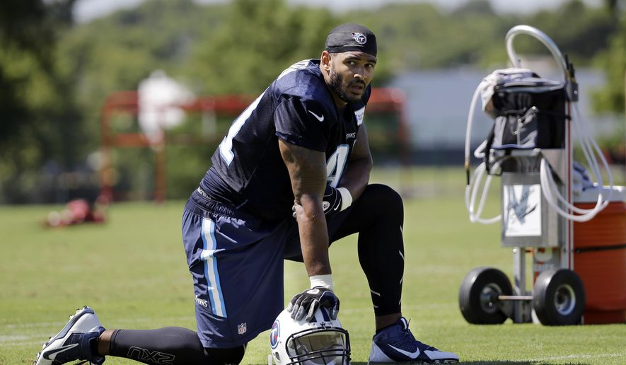 In this July 31, 2015 photo, Tennessee Titans linebacker Derrick Morgan takes a break during NFL football training camp in Nashville, Tenn. Morgan looked at other teams this offseason before the Titans convinced him to sign a new deal. Now he's paired opposite three-time Pro Bowler Brian Orakpo looking to improve off the best season of his career. (AP Photo/Mark Humphrey)