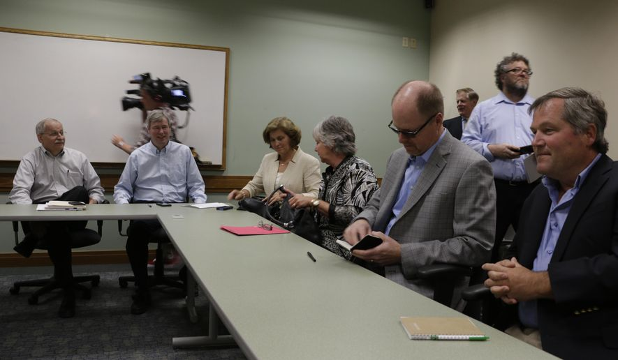 Democratic and Republican legislative leaders set up for a meeting with Gov. Jay Inslee to discuss recent sanctions by the state Supreme Court, Monday, Aug. 17, 2015, in SeaTac, Wash. The state is being fined $100,000 a day, to be put in a special education account, for its lack of progress on a plan to full fund basic education. (AP Photo/Rachel La Corte)
