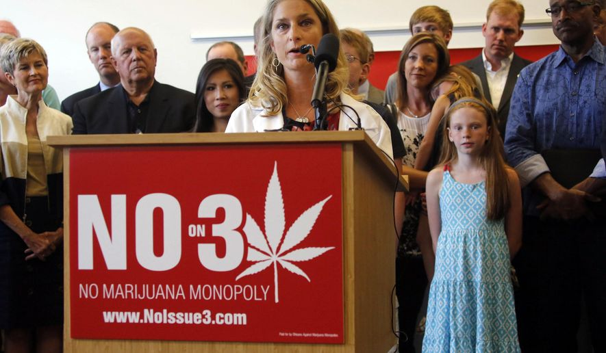 Dr Sarah Denny Attending Pediatric Physician, Nationwide Children's Hospital, Executive Board Member, Ohio Chapter of the American Academy of Pediatrics speaks during a Coalition opposing ResponsibleOhio's proposed Constitutional amendment to create a marijuana monopoly at the  Nationwide Children's Hospital Research Institute Building in Columbus, Ohio, Monday, Aug. 17, 2015. (Tom Dodge/The Columbus Dispatch via AP)