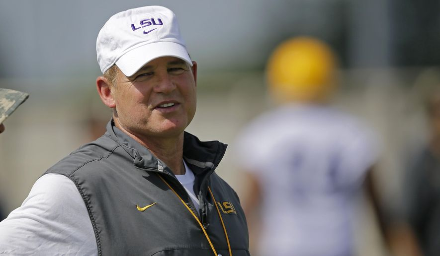 FILE - In this Aug. 7, 2015, file photo, LSU head coach Les Miles watches during NCAA college football practice in Baton Rouge, La. Les Miles enters his second decade as LSU's coach facing a little more pressure than usual.  (AP Photo/Gerald Herbert, File)
