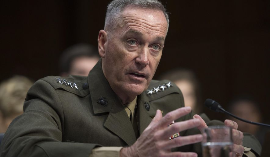 FILE - In this July 9, 2015, file photo, then-Marine Corps Commandant Gen. Joseph Dunford, Jr., testifies during his Senate Armed Services Committee confirmation hearing to become the Chairman of the Joint Chiefs of Staff, on Capitol Hill in Washington. Faced with escalating aggression from Russia and China, the Pentagon is planning to increase its use of drones by about 50 percent over the next several years. Top military leaders, including the incoming chairman of the Joint Chiefs of  Dunford, have named Russia as the nation's most serious security threat. (AP Photo/Cliff Owen, File)