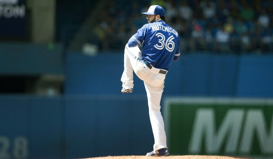 Toronto Blue Jays starting pitcher Drew Hutchison goes into his wind up on the mound before throwing against the New York Yankees during the sixth inning of a baseball game in Toronto on Sunday, Aug. 16, 2015. (Fred Thornhill /The Canadian Press via AP) MANDATORY CREDIT