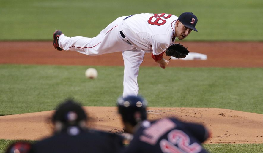 Boston Red Sox starting pitcher Matt Barnes delivers to the Cleveland Indians during the first inning of a baseball game at Fenway Park in Boston, Monday, Aug. 17, 2015. (AP Photo/Charles Krupa)