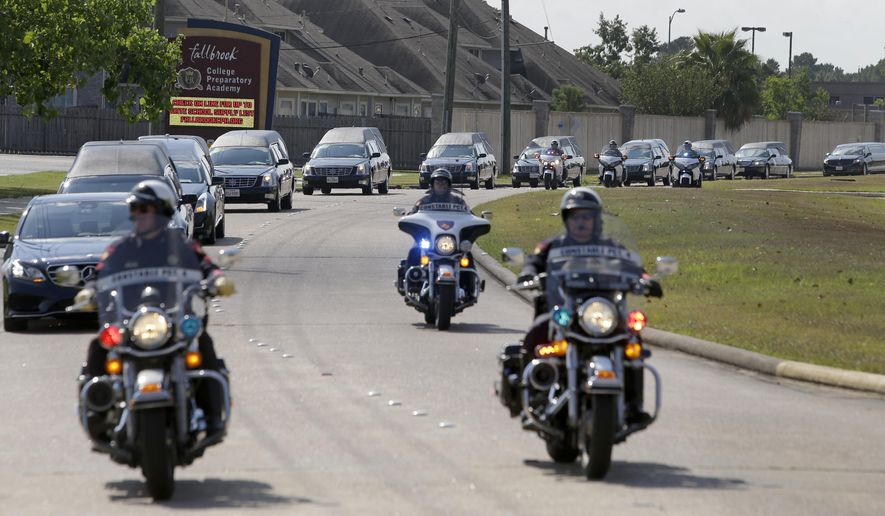 The procession of hearses arrive for a memorial service at Fallbrook Church, Monday, Aug. 17, 2015, in Houston for a couple and six children killed in an Aug. 8 mass shooting in northwest Harris County. David Conley, the father of one of the children, faces capital murder charges from the shooting. Killed in the Aug. 8 shooting were: Conley's former domestic partner, 40-year-old Valerie Jackson; her husband, 50-year-old Dwayne Jackson; 13-year-old Nathaniel, 11-year-old Honesty, 10-year-old Dwayne, 9-year-old Caleb, 7-year-old Trinity and 6-year-old Jonah. Authorities say Nathaniel was Conley's son with Valerie Jackson. The Jacksons were the parents of the other five children. (Melissa Phillip/Houston Chronicle via AP )