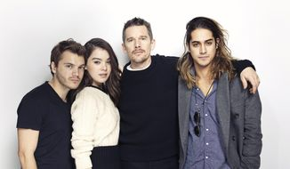 "From left, Emile Hirsch, Hailee Steinfeld, Ethan Hawke and Avan Jogia pose for a portrait to promote the film, ""Ten Thousand Saints"" at the Eddie Bauer Adventure House during the Sundance Film Festival on Friday, Jan. 23, 2015, in Park City, Utah. (Photo by Victoria Will/Invision/AP)"