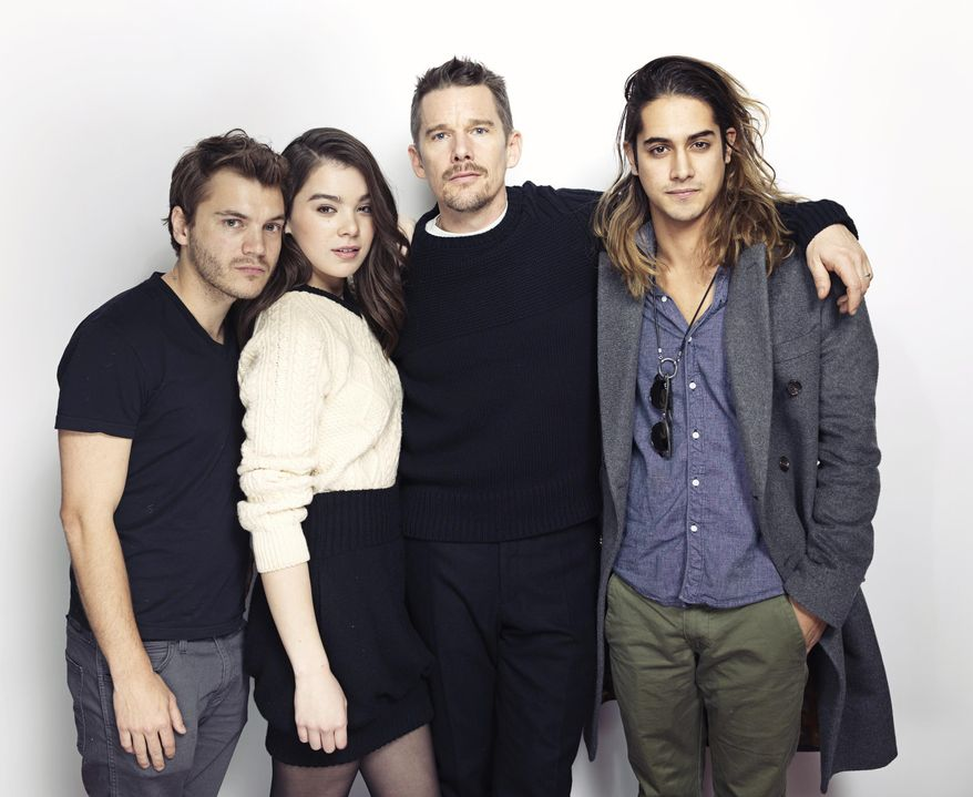 """From left, Emile Hirsch, Hailee Steinfeld, Ethan Hawke and Avan Jogia pose for a portrait to promote the film, """"Ten Thousand Saints"""" at the Eddie Bauer Adventure House during the Sundance Film Festival on Friday, Jan. 23, 2015, in Park City, Utah. (Photo by Victoria Will/Invision/AP)"""