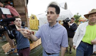 Republican presidential candidate Wisconsin Gov. Scott Walker greets fairgoers during a visit to the Iowa State Fair, Monday, Aug. 17, 2015, in Des Moines, Iowa. (AP Photo/Charlie Neibergall)